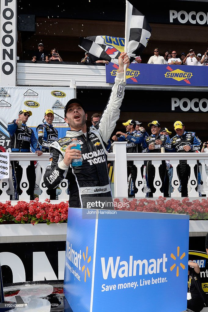 Jimmie Johnson, driver of the #48 Lowe's/Kobalt Tools Chevrolet, celebrates in Victory Lane after winning the NASCAR Sprint Cup Series Party in the Poconos 400 at Pocono Raceway on June 9, 2013 in Long Pond, Pennsylvania.