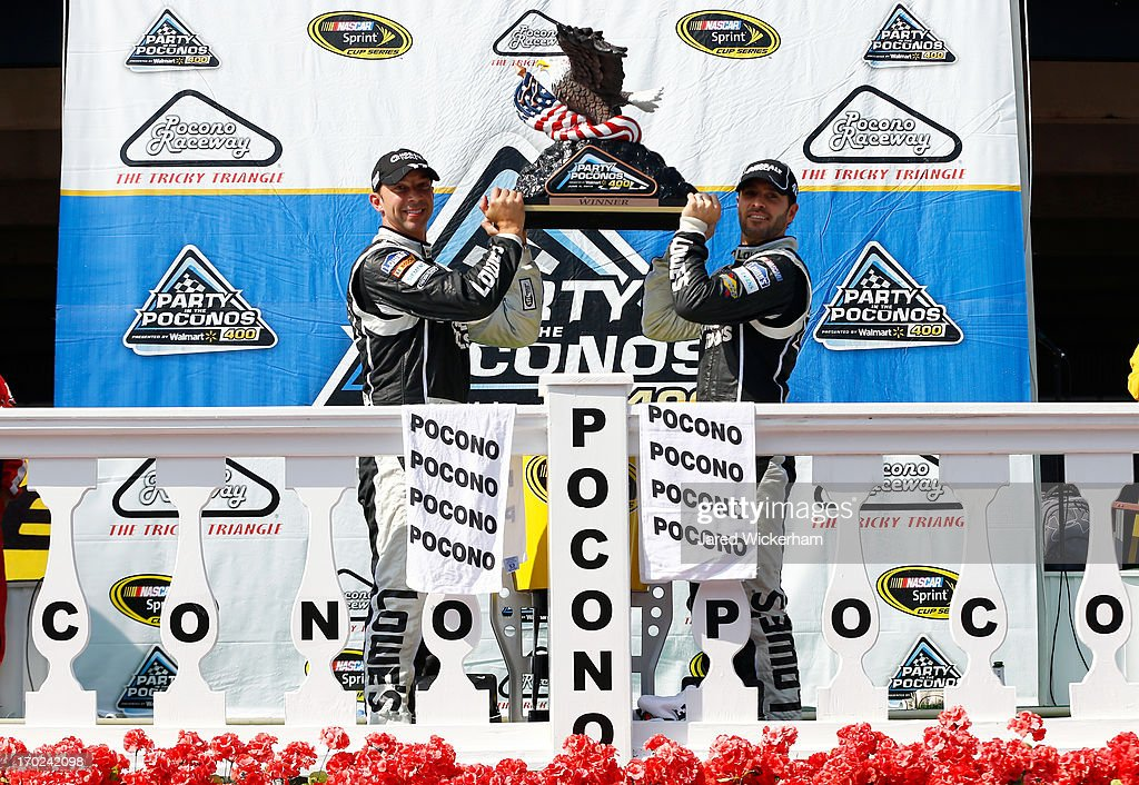 Jimmie Johnson, driver of the #48 Lowe's/Kobalt Tools Chevrolet, celebrates with his crew chief Chad Knaus in Victory Lane after winning the NASCAR Sprint Cup Series Party in the Poconos 400 at Pocono Raceway on June 9, 2013 in Long Pond, Pennsylvania.