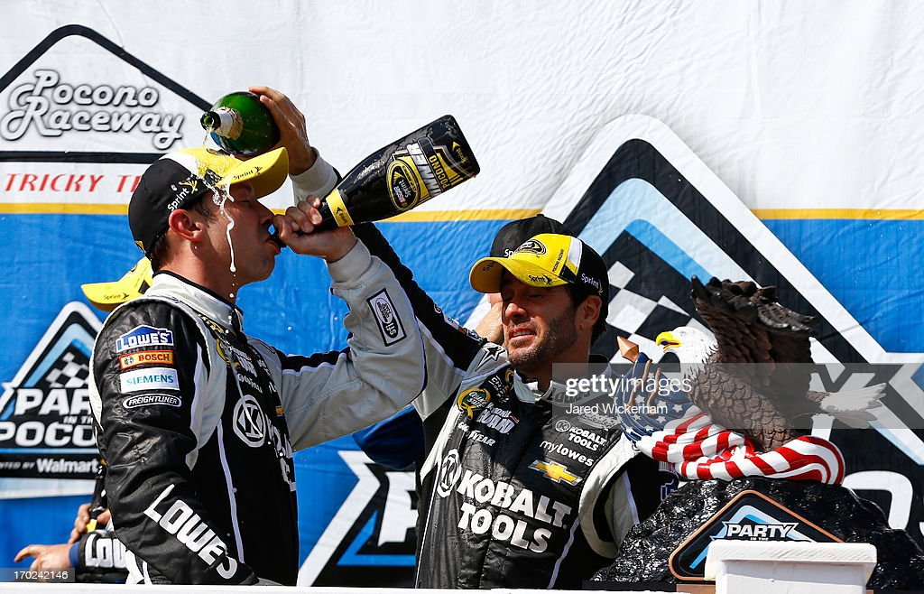 <a gi-track='captionPersonalityLinkClicked' href=/galleries/search?phrase=Jimmie+Johnson+-+Nascar+Race+Driver&family=editorial&specificpeople=171519 ng-click='$event.stopPropagation()'>Jimmie Johnson</a>, driver of the #48 Lowe's/Kobalt Tools Chevrolet, celebrates with his crew chief <a gi-track='captionPersonalityLinkClicked' href=/galleries/search?phrase=Chad+Knaus&family=editorial&specificpeople=564401 ng-click='$event.stopPropagation()'>Chad Knaus</a> in Victory Lane after winning the NASCAR Sprint Cup Series Party in the Poconos 400 at Pocono Raceway on June 9, 2013 in Long Pond, Pennsylvania.