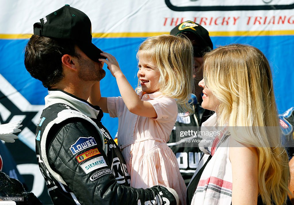 Jimmie Johnson, driver of the #48 Lowe's/Kobalt Tools Chevrolet, celebrates in Victory Lane with his wife Chandra and daughter Genevieve Marie after winning the NASCAR Sprint Cup Series Party in the Poconos 400 at Pocono Raceway on June 9, 2013 in Long Pond, Pennsylvania.
