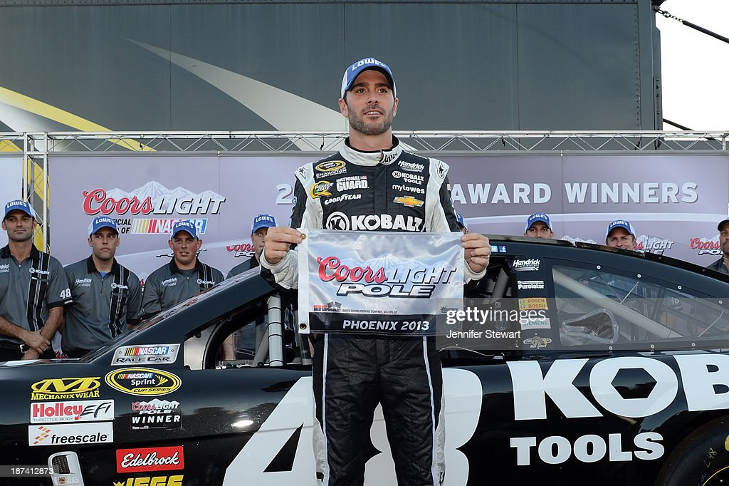 Jimmie Johnson, driver of the #48 Lowe's/Kobalt Tools Chevrolet, celebrates after setting the pole position in qualifying for the NASCAR Sprint Cup Series Advocare 500 at Phoenix International Raceway on November 8, 2013 in Avondale, Arizona.
