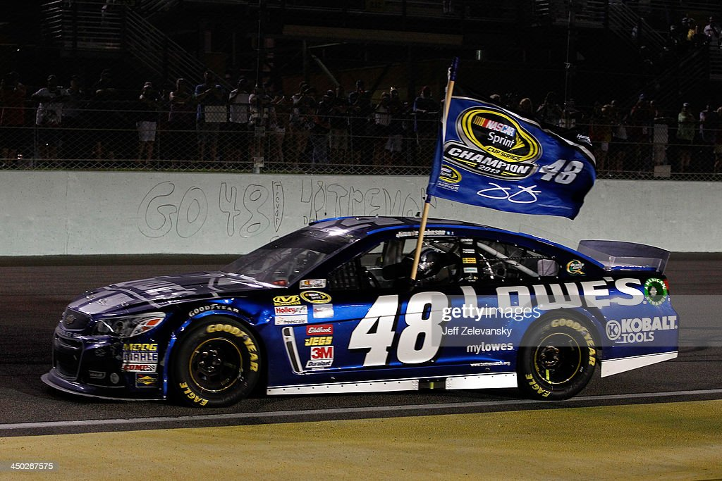 Jimmie Johnson, driver of the #48 Lowe's/Kobalt Tools Chevrolet, celebrates after winning the series championship after the NASCAR Sprint Cup Series Ford EcoBoost 400 at Homestead-Miami Speedway on November 17, 2013 in Homestead, Florida.