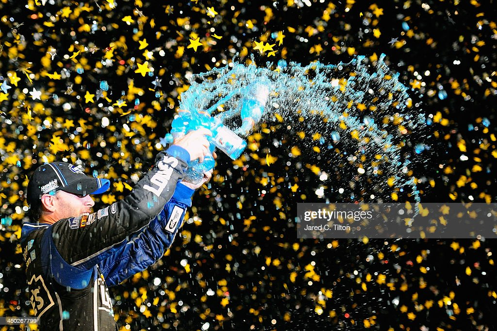 Jimmie Johnson, driver of the #48 Lowe's/Kobalt Tools Chevrolet, celebrates in Champions Victory Lane after winning the series championship following the NASCAR Sprint Cup Series Ford EcoBoost 400 at Homestead-Miami Speedway on November 17, 2013 in Homestead, Florida.