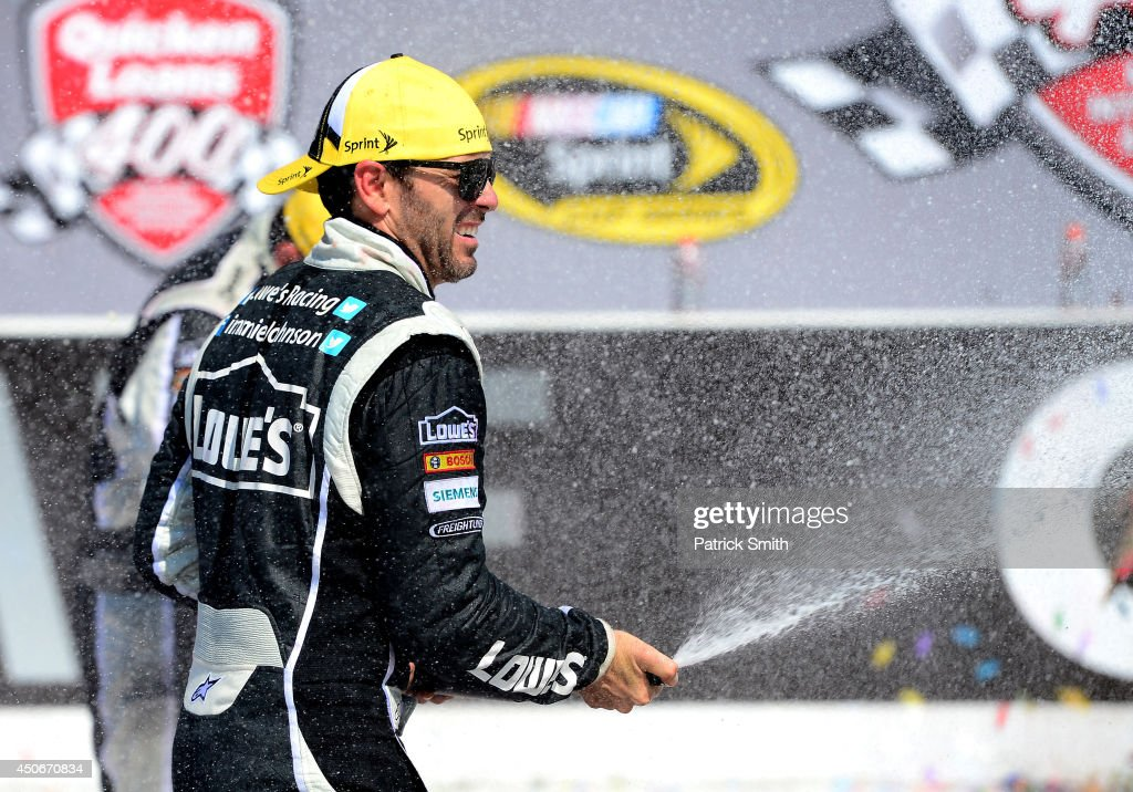 Jimmie Johnson, driver of the #48 Lowe's/Kobalt Tools Chevrolet, celebrates in Victory Lane after winning the NASCAR Sprint Cup Series Quicken Loans 400 at Michigan International Speedway on June 15, 2014 in Brooklyn, Michigan.