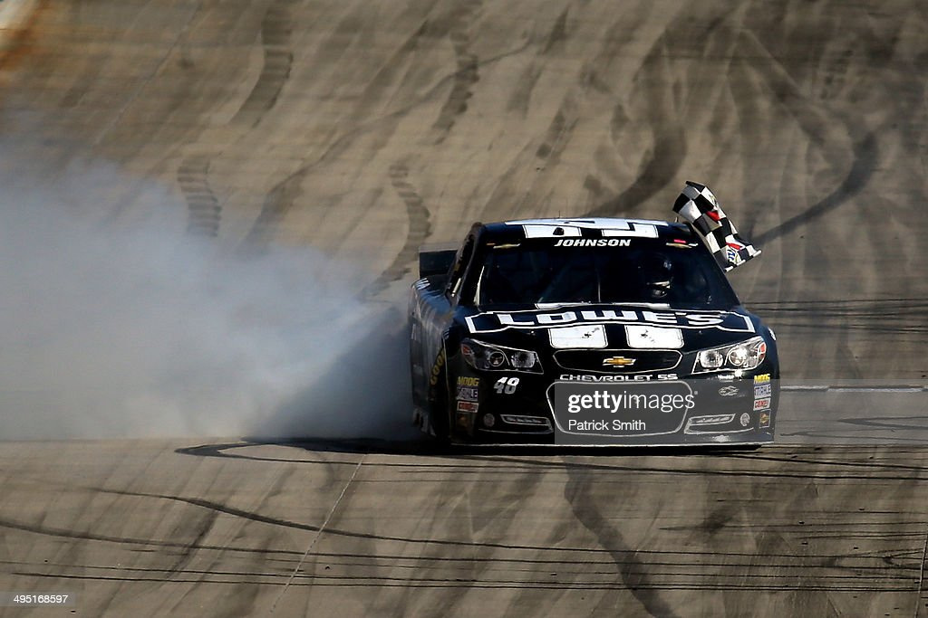 Jimmie Johnson, driver of the #48 Lowe's/Kobalt Tools Chevrolet, celebrates with a burnout after winning the NASCAR Sprint Cup Series FedEx 400 Benefiting Autism Speaks at Dover International Speedway on June 1, 2014 in Dover, Delaware.