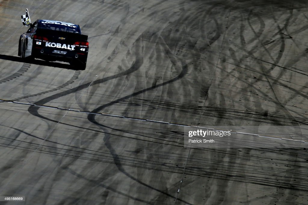 Jimmie Johnson, driver of the #48 Lowe's/Kobalt Tools Chevrolet, celebrates after winning during the NASCAR Sprint Cup Series FedEx 400 Benefiting Autism Speaks at Dover International Speedway on June 1, 2014 in Dover, Delaware.