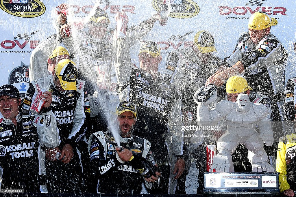<a gi-track='captionPersonalityLinkClicked' href=/galleries/search?phrase=Jimmie+Johnson+-+Nascar+Race+Driver&family=editorial&specificpeople=171519 ng-click='$event.stopPropagation()'>Jimmie Johnson</a>, driver of the #48 Lowe's/Kobalt Tools Chevrolet, celebrates with his team in victory lane after winning the NASCAR Sprint Cup Series FedEx 400 Benefiting Autism Speaks at Dover International Speedway on June 1, 2014 in Dover, Delaware.