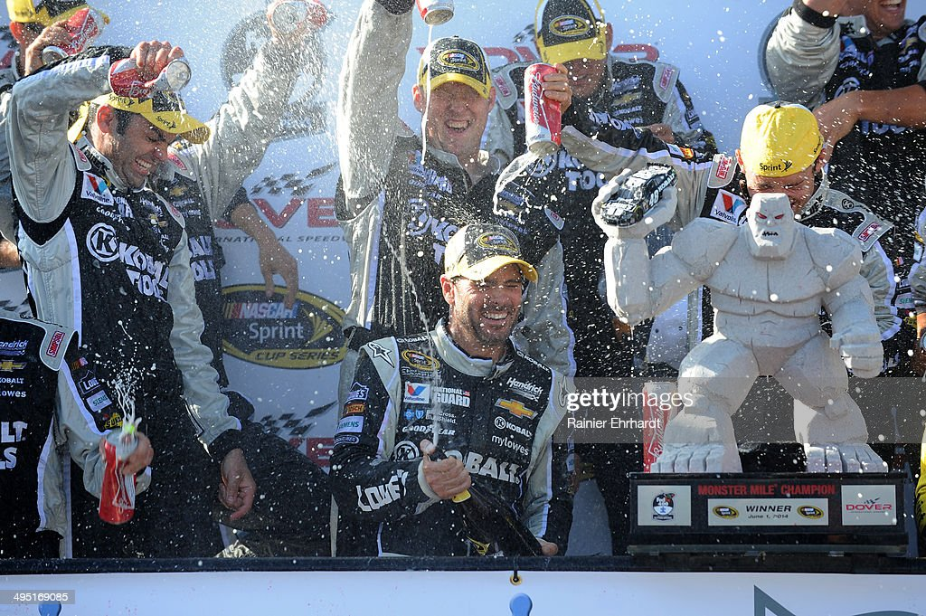 <a gi-track='captionPersonalityLinkClicked' href=/galleries/search?phrase=Jimmie+Johnson+-+Nascar+Race+Driver&family=editorial&specificpeople=171519 ng-click='$event.stopPropagation()'>Jimmie Johnson</a>, driver of the #48 Lowe's/Kobalt Tools Chevrolet, celebrates with champagne in Victory Lane after winning the NASCAR Sprint Cup Series FedEx 400 Benefiting Autism Speaks at Dover International Speedway on June 1, 2014 in Dover, Delaware.