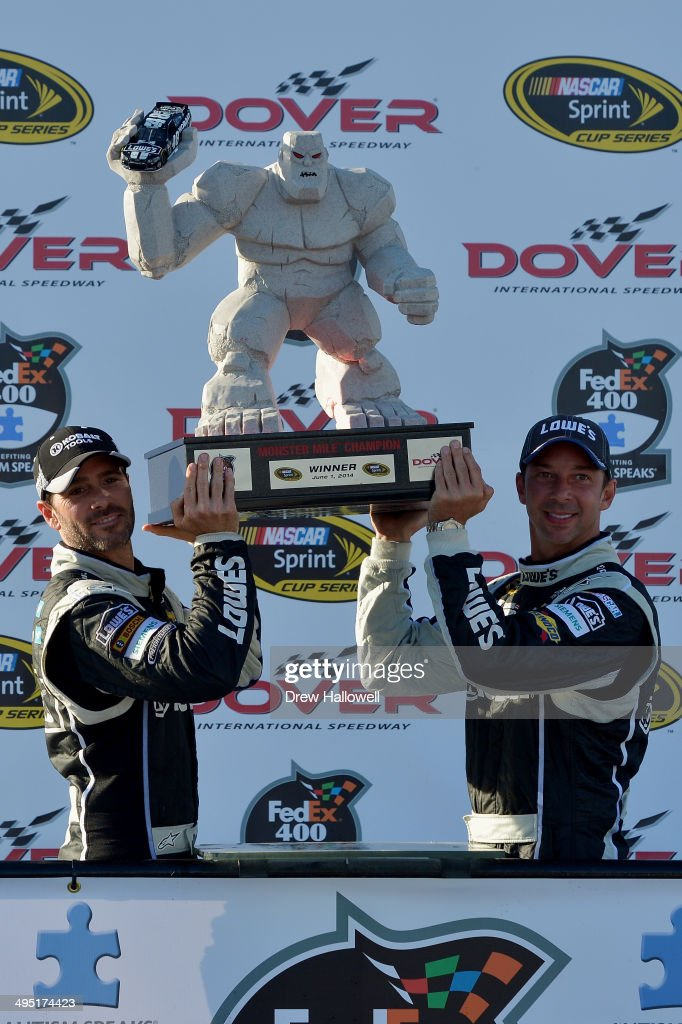Jimmie Johnson, driver of the #48 Lowe's/Kobalt Tools Chevrolet, celebrates in victory lane with crew chief Chad Knaus after winning the NASCAR Sprint Cup Series FedEx 400 Benefiting Autism Speaks at Dover International Speedway on June 1, 2014 in Dover, Delaware.