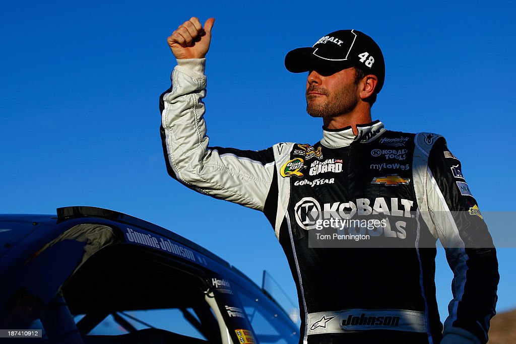 Jimmie Johnson, driver of the #48 Lowe's/Kobalt Tools Chevrolet, gives the thumbs up after qualifying for the NASCAR Sprint Cup Series Advocare 500 at Phoenix International Raceway on November 8, 2013 in Avondale, Arizona.