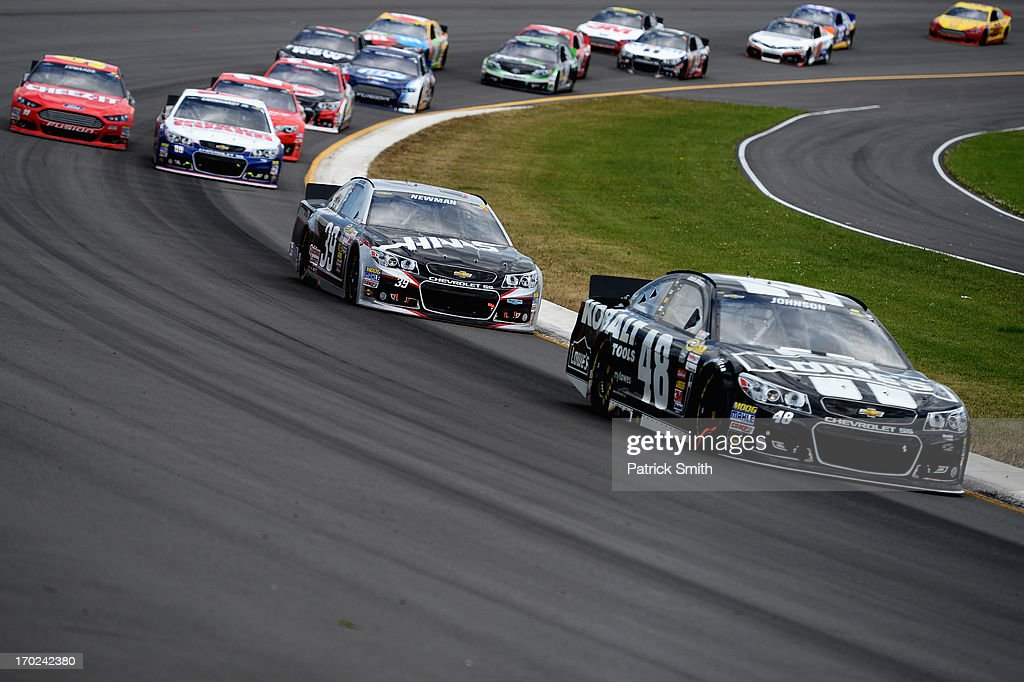 <a gi-track='captionPersonalityLinkClicked' href=/galleries/search?phrase=Jimmie+Johnson+-+Nascar+Race+Driver&family=editorial&specificpeople=171519 ng-click='$event.stopPropagation()'>Jimmie Johnson</a>, driver of the #48 Lowe's/Kobalt Tools Chevrolet, leads a group of cars during the NASCAR Sprint Cup Series Party in the Poconos 400 at Pocono Raceway on June 9, 2013 in Long Pond, Pennsylvania.