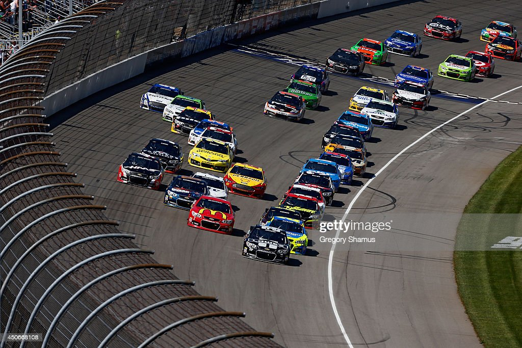 Jimmie Johnson, driver of the #48 Lowe's/Kobalt Tools Chevrolet, leads a pack of cars during the NASCAR Sprint Cup Series Quicken Loans 400 at Michigan International Speedway on June 15, 2014 in Brooklyn, Michigan.