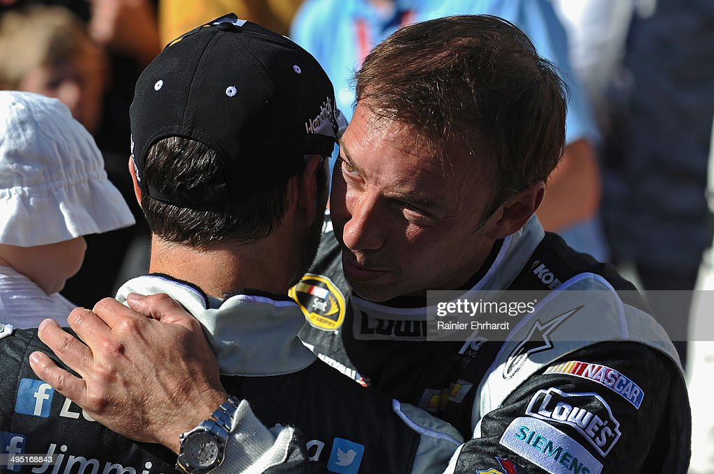 Jimmie Johnson, driver of the #48 Lowe's/Kobalt Tools Chevrolet, left, celebrates with crew chief Chad Knaus in Victory Lane after winning the NASCAR Sprint Cup Series FedEx 400 Benefiting Autism Speaks at Dover International Speedway on June 1, 2014 in Dover, Delaware.
