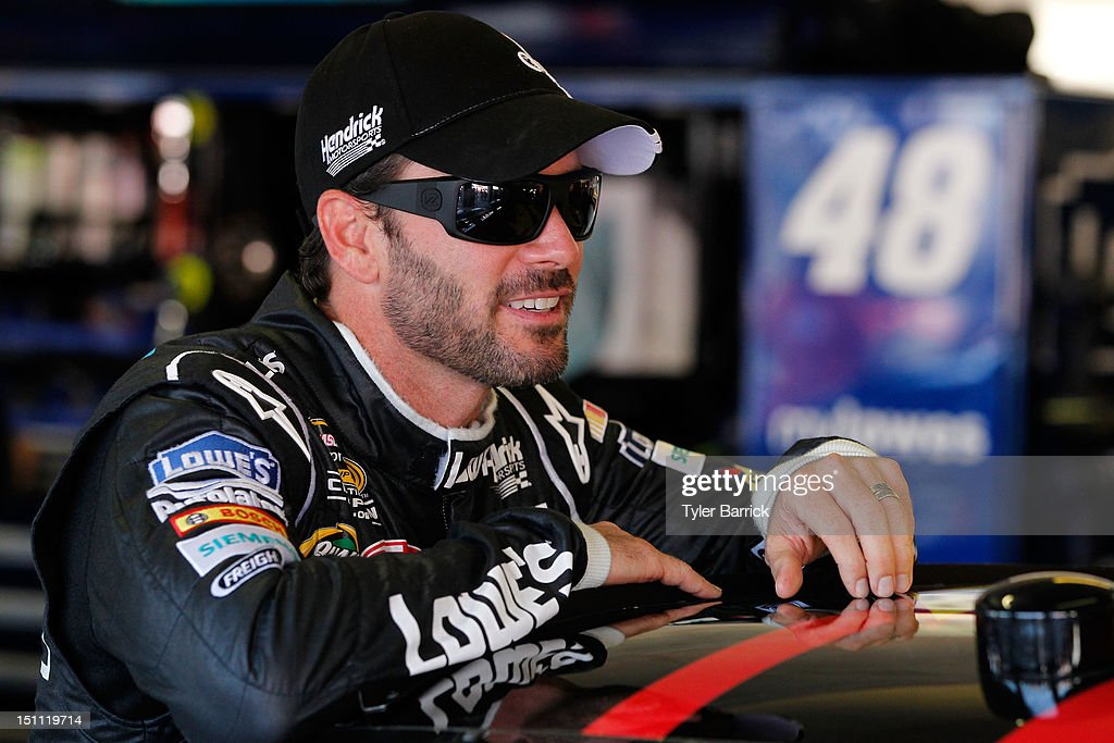 <a gi-track='captionPersonalityLinkClicked' href=/galleries/search?phrase=Jimmie+Johnson+-+Nascar+Race+Driver&family=editorial&specificpeople=171519 ng-click='$event.stopPropagation()'>Jimmie Johnson</a>, driver of the #48 Lowe's/Kobalt Tools Chevrolet, looks on in the garage before the start of practice for the NASCAR Sprint Cup Series AdvoCare 500 at Atlanta Motor Speedway on September 1, 2012 in Hampton, Georgia.