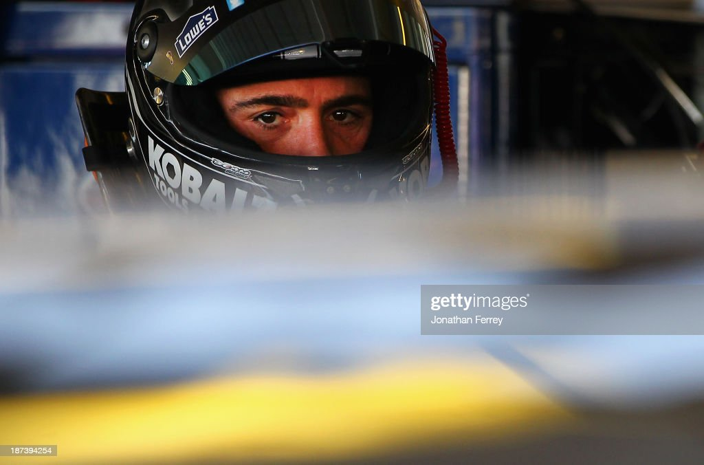 Jimmie Johnson, driver of the #48 Lowe's/Kobalt Tools Chevrolet, looks on in the garage area during practice for the NASCAR Sprint Cup Series Advocare 500 at Phoenix International Raceway on November 8, 2013 in Avondale, Arizona.