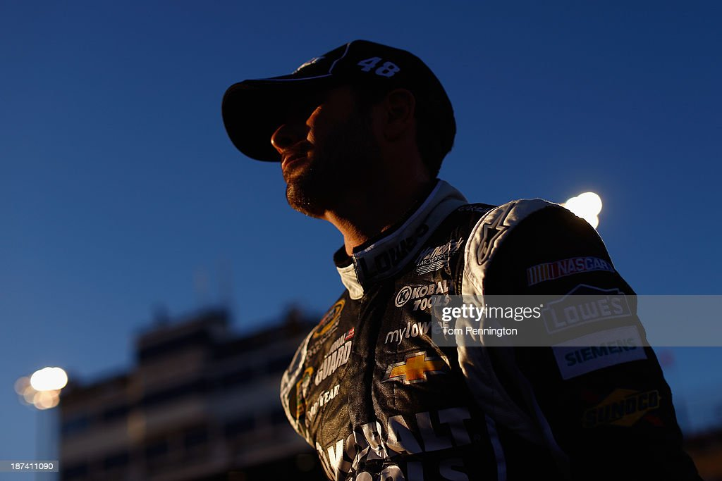 Jimmie Johnson, driver of the #48 Lowe's/Kobalt Tools Chevrolet, looks on during qualifying for the NASCAR Sprint Cup Series Advocare 500 at Phoenix International Raceway on November 8, 2013 in Avondale, Arizona.