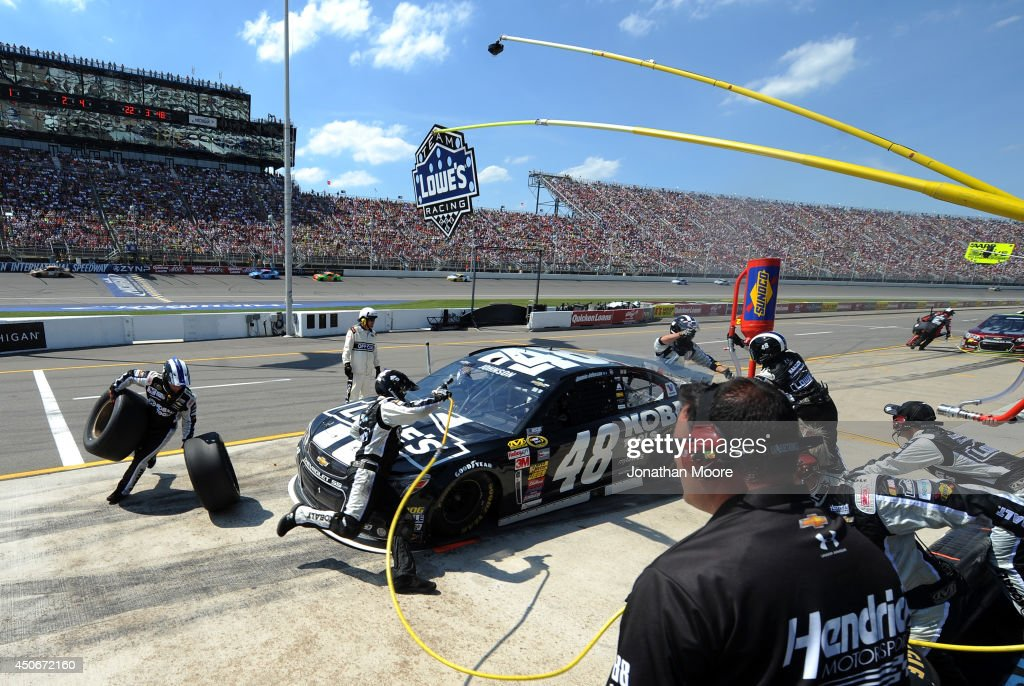 Jimmie Johnson, driver of the #48 Lowe's/Kobalt Tools Chevrolet, pits during the NASCAR Sprint Cup Series Quicken Loans 400 at Michigan International Speedway on June 15, 2014 in Brooklyn, Michigan.