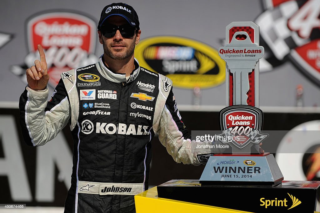 Jimmie Johnson, driver of the #48 Lowe's/Kobalt Tools Chevrolet, poses with the trophy after winning the NASCAR Sprint Cup Series Quicken Loans 400 at Michigan International Speedway on June 15, 2014 in Brooklyn, Michigan.