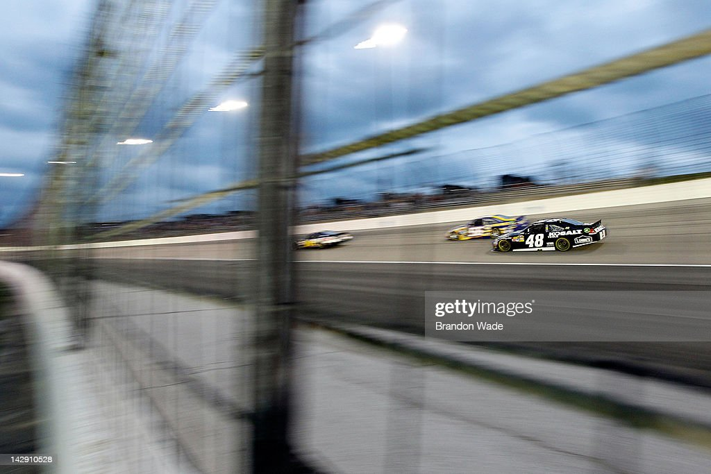 <a gi-track='captionPersonalityLinkClicked' href=/galleries/search?phrase=Jimmie+Johnson+-+Nascar+Race+Driver&family=editorial&specificpeople=171519 ng-click='$event.stopPropagation()'>Jimmie Johnson</a>, driver of the #48 Lowe's/Kobalt Tools Chevrolet, races during the NASCAR Sprint Cup Series Samsung Mobile 500 at Texas Motor Speedway on April 14, 2012 in Fort Worth, Texas.