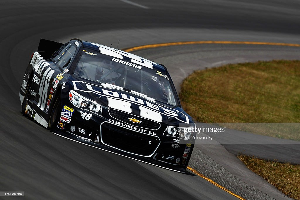 Jimmie Johnson, driver of the #48 Lowe's/Kobalt Tools Chevrolet, races during the NASCAR Sprint Cup Series Party in the Poconos 400 at Pocono Raceway on June 9, 2013 in Long Pond, Pennsylvania.