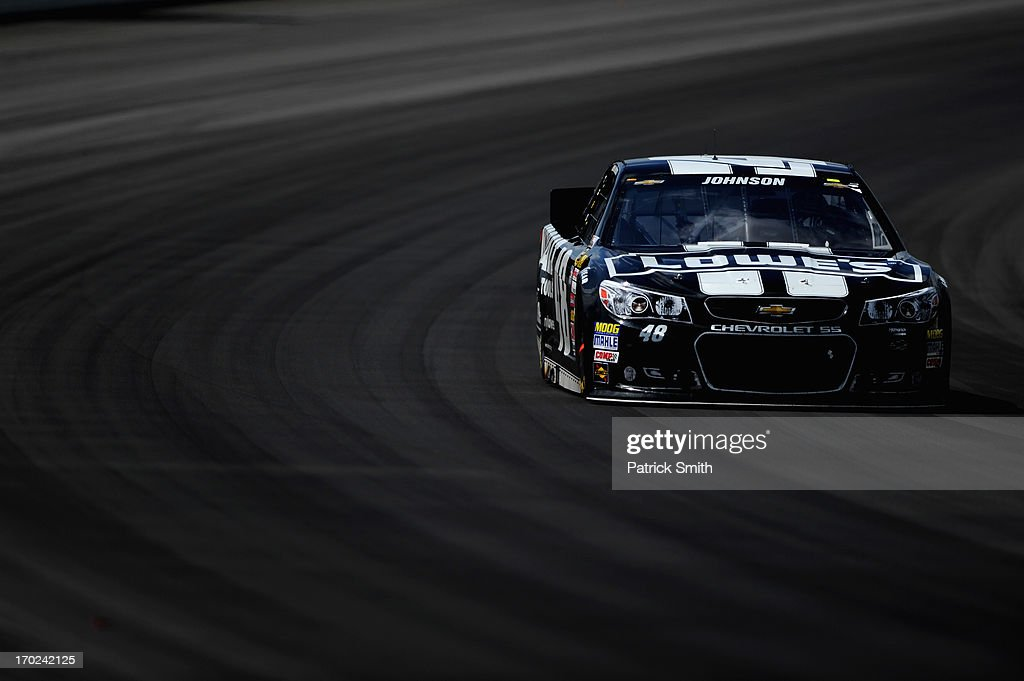 <a gi-track='captionPersonalityLinkClicked' href=/galleries/search?phrase=Jimmie+Johnson+-+Nascar+Race+Driver&family=editorial&specificpeople=171519 ng-click='$event.stopPropagation()'>Jimmie Johnson</a>, driver of the #48 Lowe's/Kobalt Tools Chevrolet, races during the NASCAR Sprint Cup Series Party in the Poconos 400 at Pocono Raceway on June 9, 2013 in Long Pond, Pennsylvania.