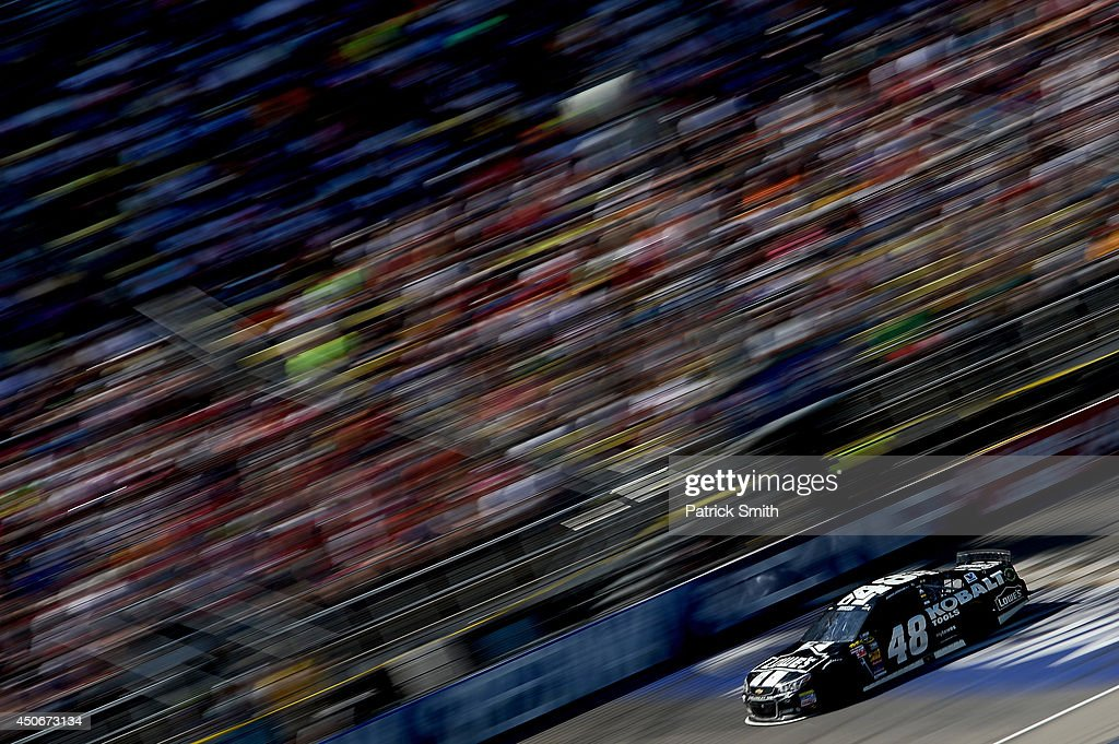 Jimmie Johnson, driver of the #48 Lowe's/Kobalt Tools Chevrolet, races the NASCAR Sprint Cup Series Quicken Loans 400 at Michigan International Speedway on June 15, 2014 in Brooklyn, Michigan.