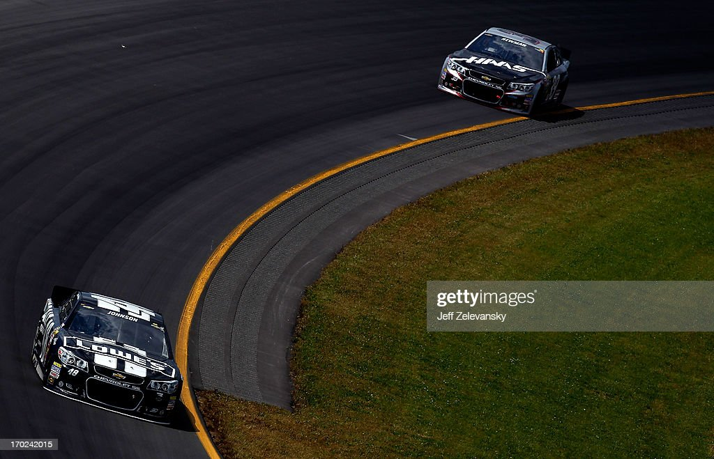 Jimmie Johnson, driver of the #48 Lowe's/Kobalt Tools Chevrolet, races with Ryan Newman, driver of the #39 HAAS Automation Chevrolet, during the NASCAR Sprint Cup Series Party in the Poconos 400 at Pocono Raceway on June 9, 2013 in Long Pond, Pennsylvania.