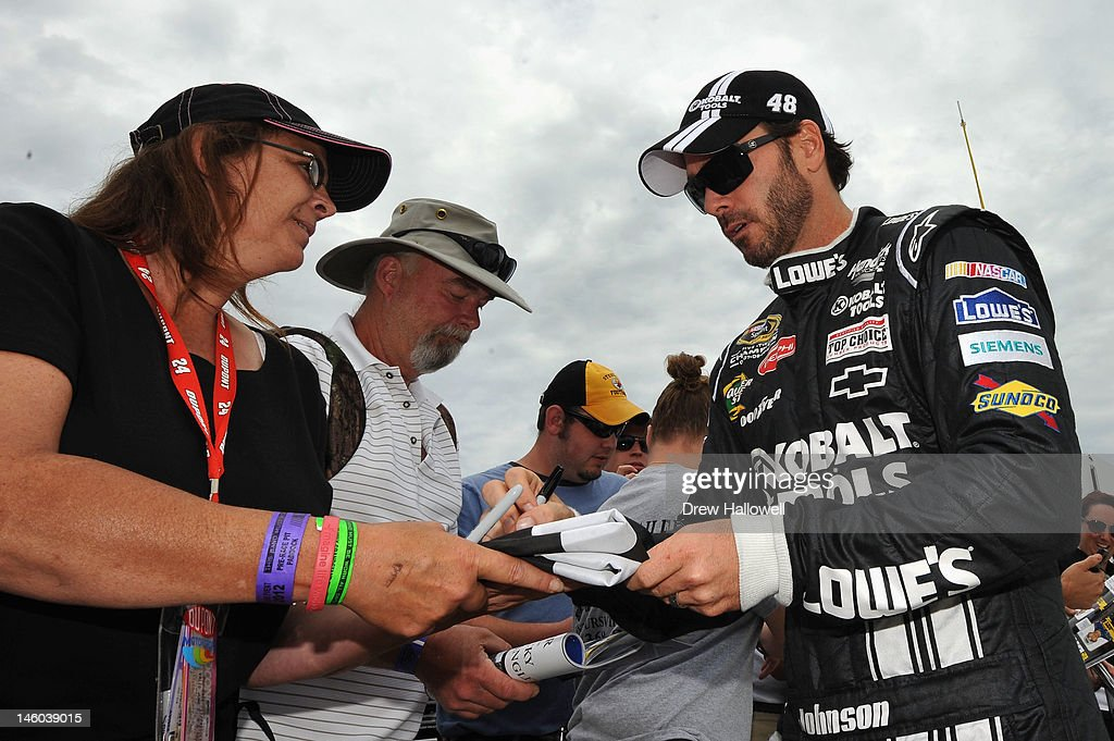 <a gi-track='captionPersonalityLinkClicked' href=/galleries/search?phrase=Jimmie+Johnson+-+Nascar+Race+Driver&family=editorial&specificpeople=171519 ng-click='$event.stopPropagation()'>Jimmie Johnson</a>, driver of the #48 Lowe's/Kobalt Tools Chevrolet, signs autographs on the grid during qualifying for the NASCAR Sprint Cup Series Pocono 400 presented by #NASCAR at Pocono Raceway on June 9, 2012 in Long Pond, Pennsylvania.