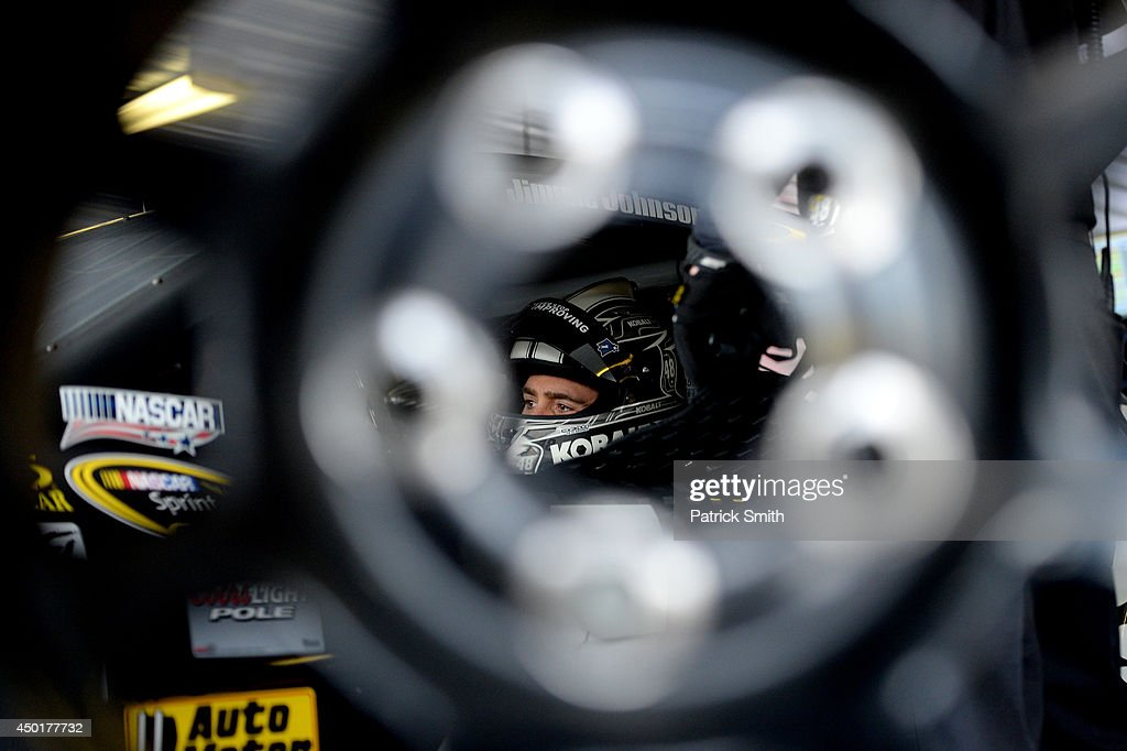 Jimmie Johnson, driver of the #48 Lowe's/Kobalt Tools Chevrolet, sits in his car during practice for the NASCAR Sprint Cup Series Pocono 400 at Pocono Raceway on June 6, 2014 in Long Pond, Pennsylvania.