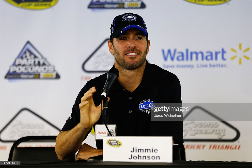 <a gi-track='captionPersonalityLinkClicked' href=/galleries/search?phrase=Jimmie+Johnson+-+Nascar+Race+Driver&family=editorial&specificpeople=171519 ng-click='$event.stopPropagation()'>Jimmie Johnson</a>, driver of the #48 Lowe's/Kobalt Tools Chevrolet, speaks to the media during a rain delay at Pocono Raceway on June 7, 2013 in Long Pond, Pennsylvania.