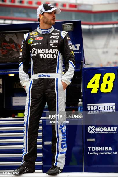 Jimmie Johnson driver of the Lowe's/Kobalt Tools Chevrolet stands in the garage area during practice for the NASCAR Sprint Cup Series Jeff Byrd 500...