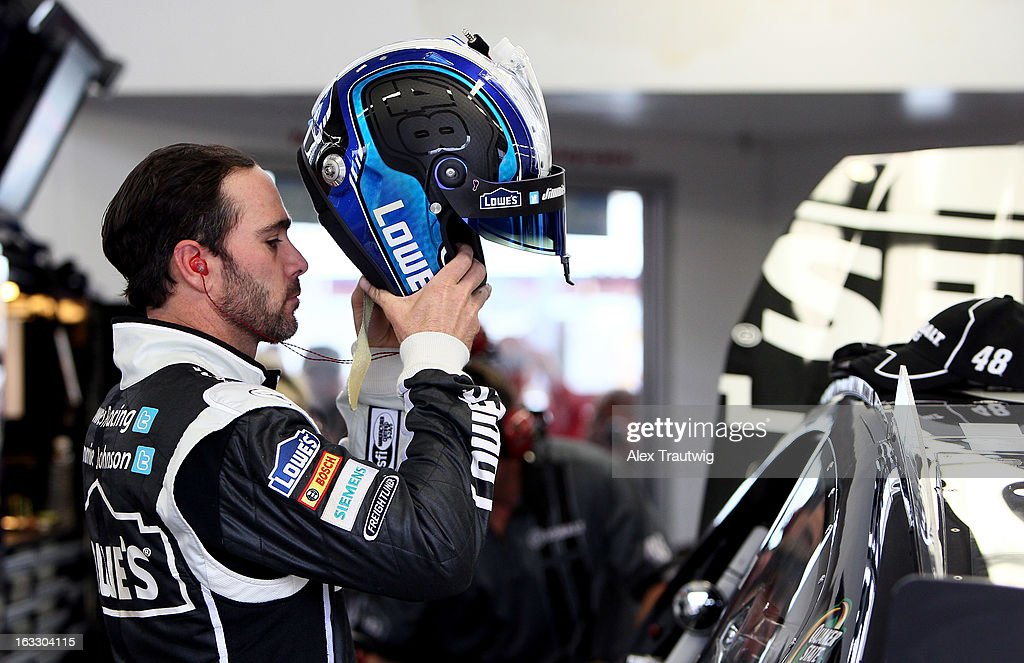 <a gi-track='captionPersonalityLinkClicked' href=/galleries/search?phrase=Jimmie+Johnson+-+Nascar+Race+Driver&family=editorial&specificpeople=171519 ng-click='$event.stopPropagation()'>Jimmie Johnson</a>, driver of the #48 Lowe's/Kobalt Tools Chevrolet, stands in the garage area during NASCAR Sprint Cup Series testing at Las Vegas Motor Speedway on March 7, 2013 in Las Vegas, Nevada.