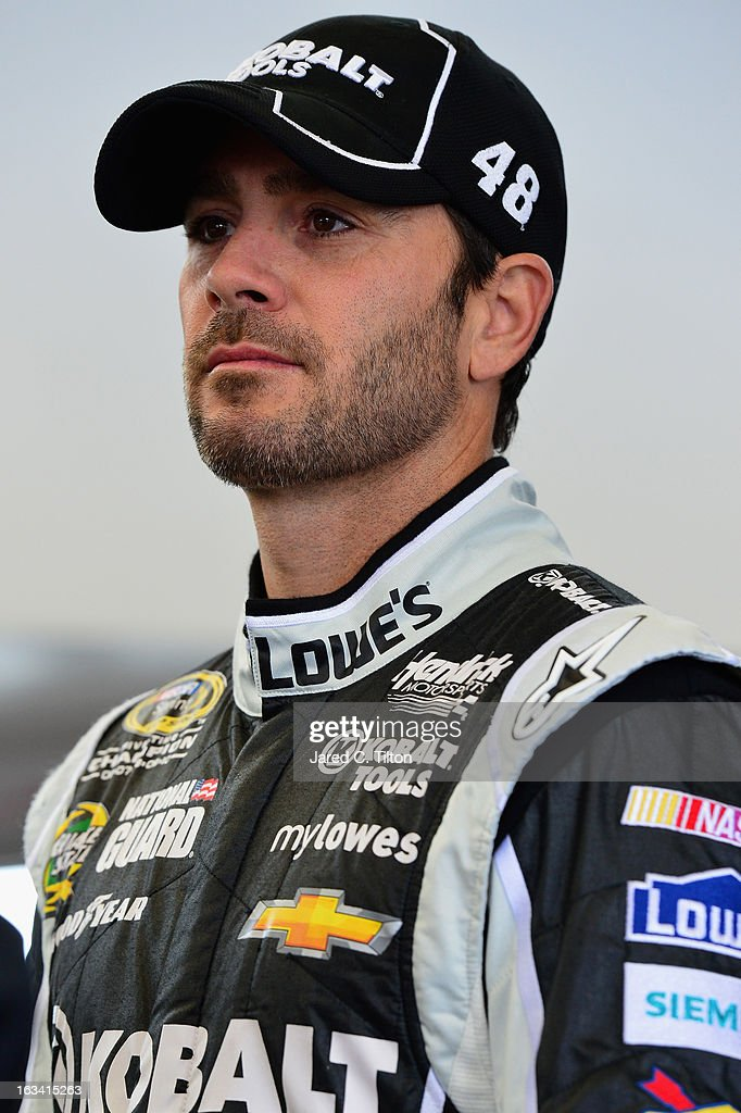 Jimmie Johnson, driver of the #48 Lowe's/Kobalt Tools Chevrolet, stands in the garage area during practice for the NASCAR Sprint Cup Series Kobalt Tools 400 at Las Vegas Motor Speedway on March 9, 2013 in Las Vegas, Nevada.