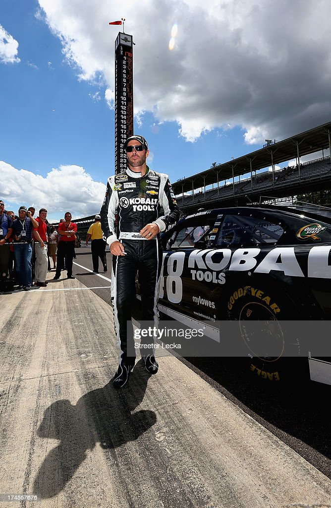 <a gi-track='captionPersonalityLinkClicked' href=/galleries/search?phrase=Jimmie+Johnson+-+Nascar+Race+Driver&family=editorial&specificpeople=171519 ng-click='$event.stopPropagation()'>Jimmie Johnson</a>, driver of the #48 Lowe's/Kobalt Tools Chevrolet, stands on the grid during qualifying for the NASCAR Sprint Cup Series Samuel Deeds 400 At The Brickyard at Indianapolis Motor Speedway on July 27, 2013 in Indianapolis, Indiana.