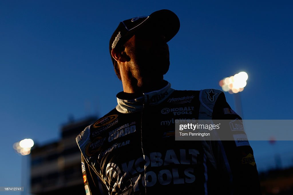 Jimmie Johnson, driver of the #48 Lowe's/Kobalt Tools Chevrolet, stands on the grid during qualifying for the NASCAR Sprint Cup Series Advocare 500 at Phoenix International Raceway on November 8, 2013 in Avondale, Arizona.
