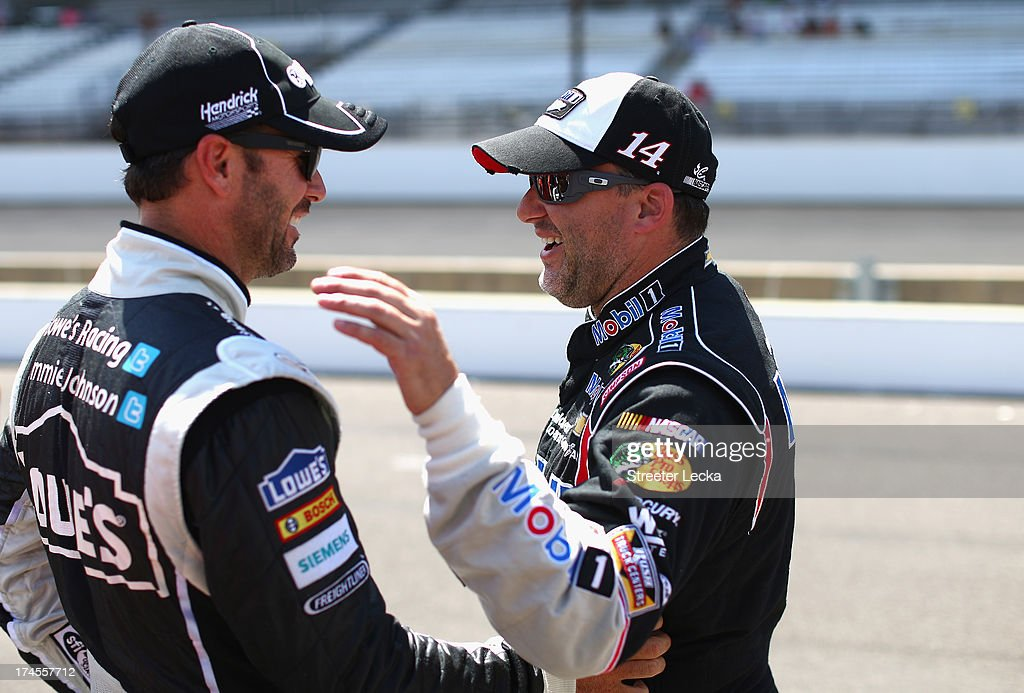 <a gi-track='captionPersonalityLinkClicked' href=/galleries/search?phrase=Jimmie+Johnson+-+Nascar+Race+Driver&family=editorial&specificpeople=171519 ng-click='$event.stopPropagation()'>Jimmie Johnson</a>, driver of the #48 Lowe's/Kobalt Tools Chevrolet, talks with <a gi-track='captionPersonalityLinkClicked' href=/galleries/search?phrase=Tony+Stewart+-+Race+Car+Driver&family=editorial&specificpeople=201686 ng-click='$event.stopPropagation()'>Tony Stewart</a>, driver of the #14 Bass Pro Shops/Mobil 1 Chevrolet, during qualifying for the NASCAR Sprint Cup Series Samuel Deeds 400 At The Brickyard at Indianapolis Motor Speedway on July 27, 2013 in Indianapolis, Indiana.