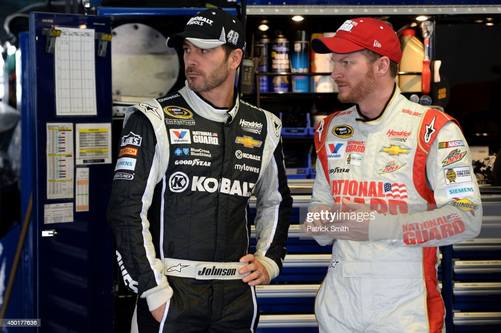 Jimmie Johnson, driver of the #48 Lowe's/Kobalt Tools Chevrolet, talks with teammate Dale Earnhardt Jr., driver of the #88 National Guard Chevrolet, in the garage area during practice for the NASCAR Sprint Cup Series Pocono 400 at Pocono Raceway on June 6, 2014 in Long Pond, Pennsylvania.