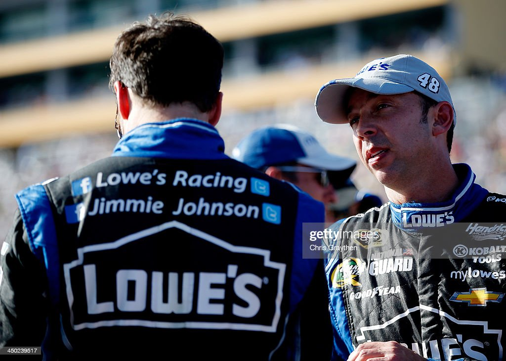 Jimmie Johnson, driver of the #48 Lowe's/Kobalt Tools Chevrolet, talks with crew chief Chad Knaus on the grid prior to the NASCAR Sprint Cup Series Ford EcoBoost 400 at Homestead-Miami Speedway on November 17, 2013 in Homestead, Florida.