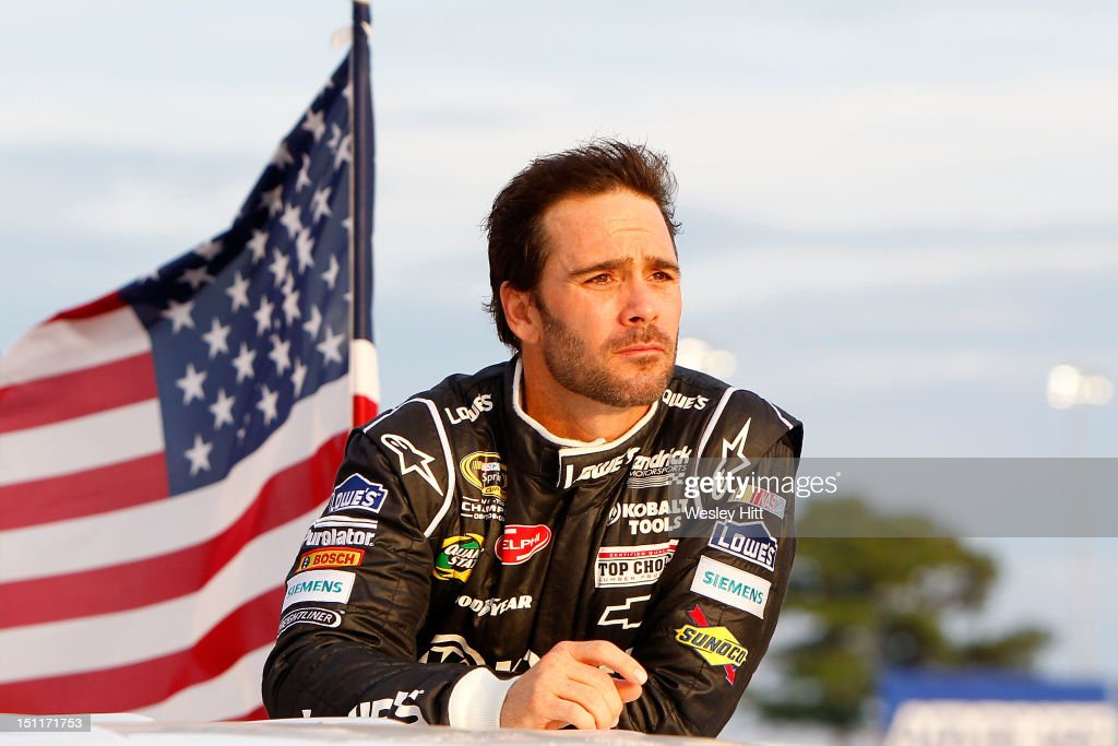 <a gi-track='captionPersonalityLinkClicked' href=/galleries/search?phrase=Jimmie+Johnson+-+Nascar+Race+Driver&family=editorial&specificpeople=171519 ng-click='$event.stopPropagation()'>Jimmie Johnson</a>, driver of the #48 Lowe's/Kobalt Tools Chevrolet, waves to the fans during driver introductions during the NASCAR Sprint Cup Series AdvoCare 500 at Atlanta Motor Speedway on September 2, 2012 in Hampton, Georgia.