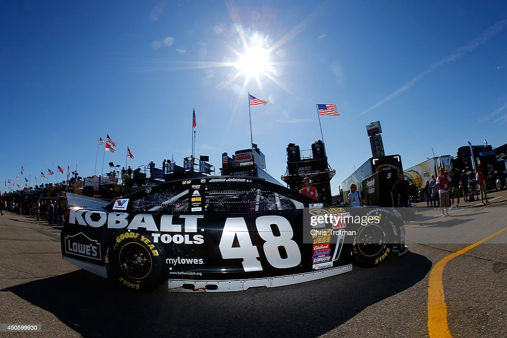 Jimmie Johnson drives the #48 Lowe's/Kobalt Tools Chevrolet through the garage area during practice for the NASCAR Sprint Cup Series Quicken Loans 400 at Michigan International Speedway on June 14, 2014 in Brooklyn, Michigan.