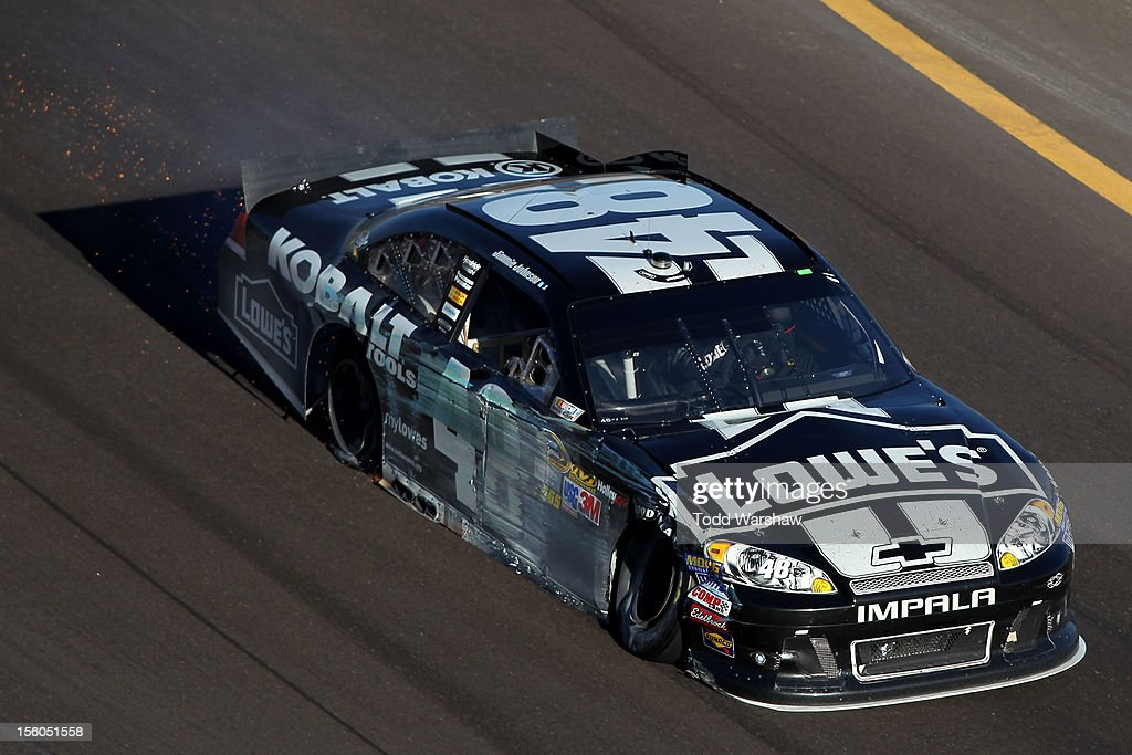 <a gi-track='captionPersonalityLinkClicked' href=/galleries/search?phrase=Jimmie+Johnson+-+Piloto+da+Nascar&family=editorial&specificpeople=171519 ng-click='$event.stopPropagation()'>Jimmie Johnson</a> drives the wrecked #48 Lowe's/Kobalt Tools Chevrolet after hitting the wall in the NASCAR Sprint Cup Series AdvoCare 500 at Phoenix International Raceway on November 11, 2012 in Avondale, Arizona.
