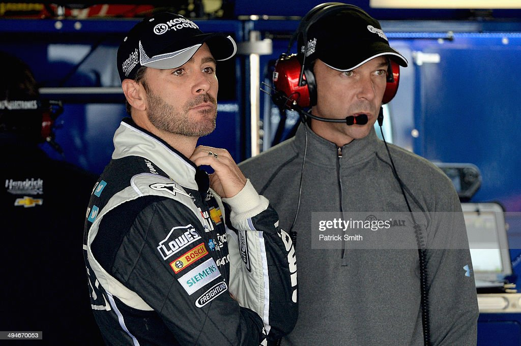 Jimmie Johnson, left, driver of the #48 Lowe's/Kobalt Tools Chevrolet, and crew chief Chad Knaus looks on in the garage area during practice for the NASCAR Sprint Cup Series FedEx 400 Benefiting Autism Speaks at Dover International Speedway on May 30, 2014 in Dover, Delaware.