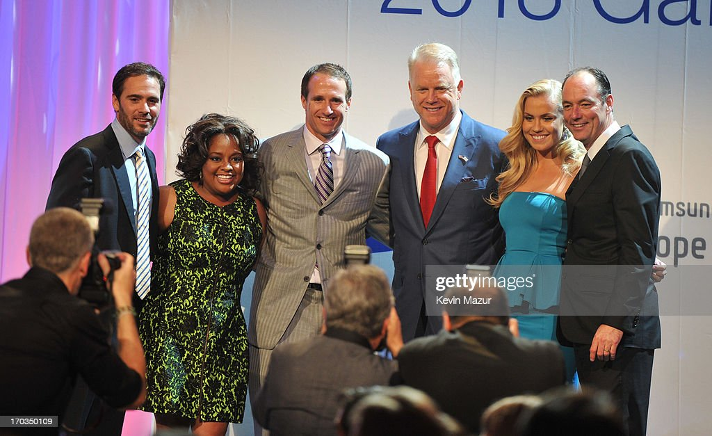 Jimmie Johnson, Sherri Shepard, Drew Brees, Boomer Esiason, Sydney Esiason and President of Samsung Electronics America Tim Baxter on stage during the Samsung's Annual Hope for Children Gala at CiprianiÕs in Wall Street on June 11, 2013 in New York City.