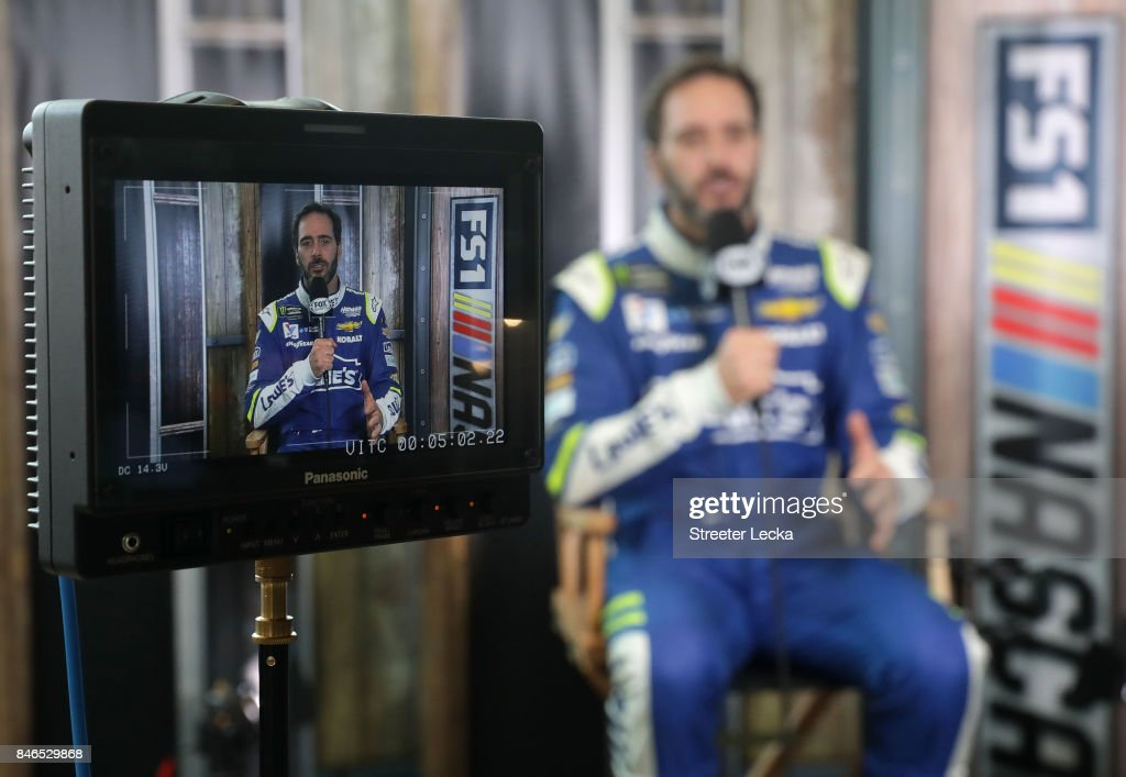 Jimmie Johnson speaks to the media as one of the 16 drivers eligible to win the Monster Energy NASCAR Cup Series Championship during the 2017 NASCAR Playoffs Production & Media Day at NASCAR Hall of Fame on September 13, 2017 in Charlotte, North Carolina.