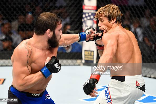 Jimmie Rivera punches Urijah Faber in their bantamweight bout during the UFC 203 event at Quicken Loans Arena on September 10 2016 in Cleveland Ohio