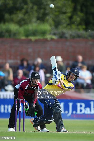 Jimmy Adams of Hampshire hits to long on as wicketkeeper Marcus Trescothick of Somerset looks on during the NatWest T20 Blast match between Somerset...