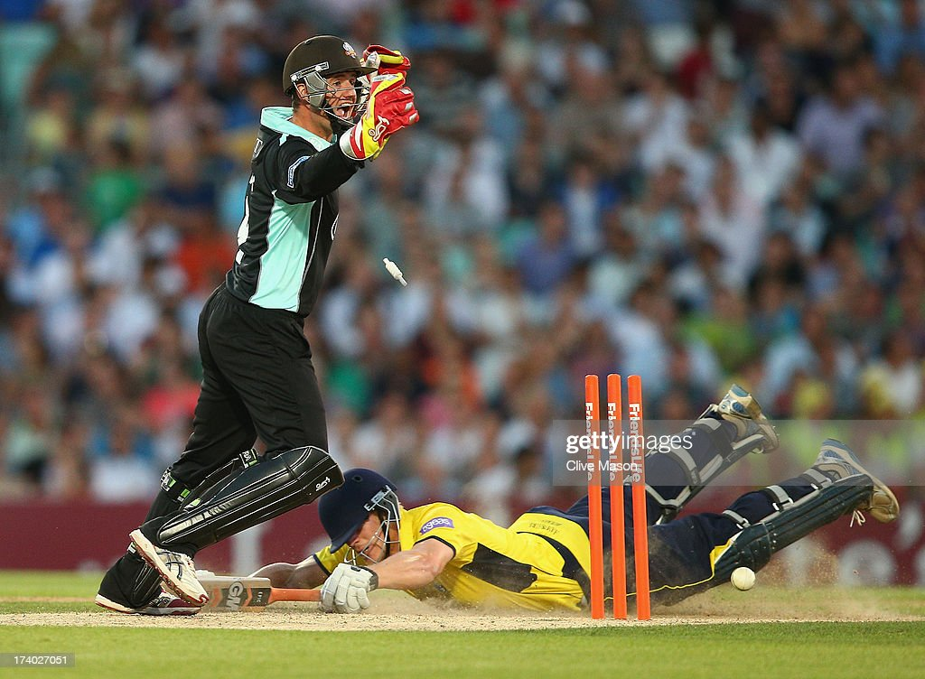 Jimmy Adams of Hampshire is run out as Steven Davies of Surrey celebrates during the Friends Life T20 match between Surrey Lions and Hampshire Royals...