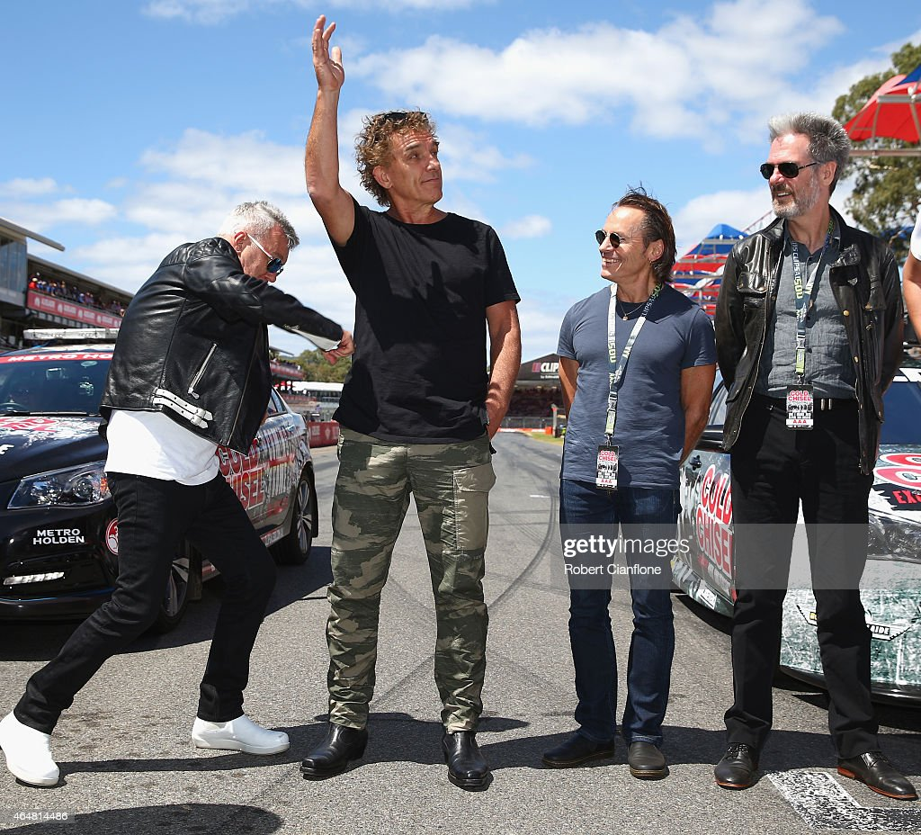 Jimmy Barnes of Cold Chisel fools around with gutarist Ian Moss as Phil Small and Don Walker look on as the band is inducted into the AMC South...