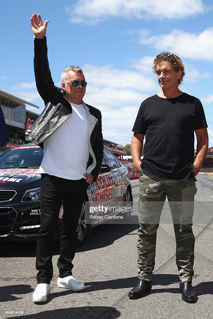 Jimmy Barnes of Cold Chisel waves to the crowd as Ian Moss looks on as the band is inducted into the AMC South Australian Music Hall of Fame during...