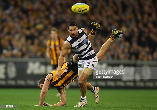 Jimmy Bartel of the Cats and Ben Stratton of the Hawks compete for the ball during the round 19 AFL match between the Hawthorn Hawks and the Geelong...